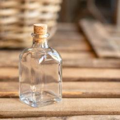 Botellita de vidrio vacía Amaya con corcho normal