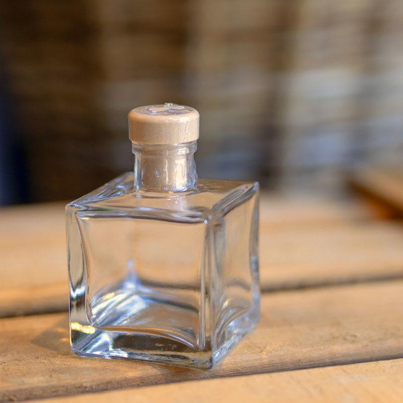 Botellita de vidrio vacía Lucas con precinto